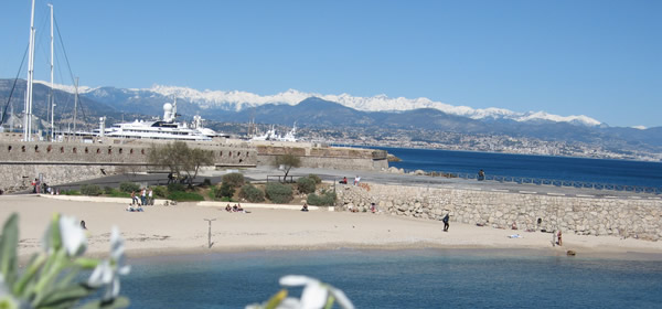 The coast at Antibes looking towards the Mercantour in the winter